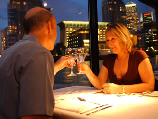 Romantic couple enjoying a Valentine's Day Thames Dinner Cruise